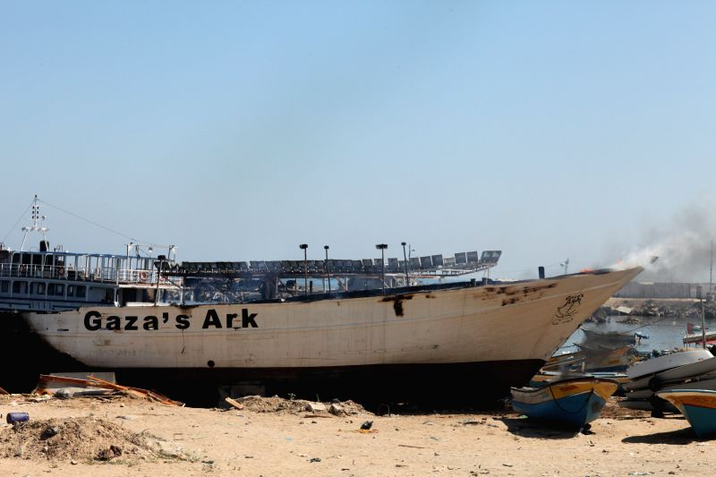 Burning boats hit in an Israeli airstrike are seen at the port in Gaza City, July 12, 2014. The Palestinian Health Ministry said in a press statement that since the ...