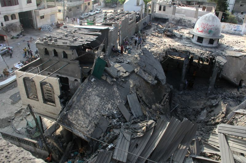 Palestinians inspect rubbles of Al-Farooq mosque destroyed in an Israeli airstrike in the southern Gaza Strip city of Rafah, on July 22, 2014. Israel's large-scale ...