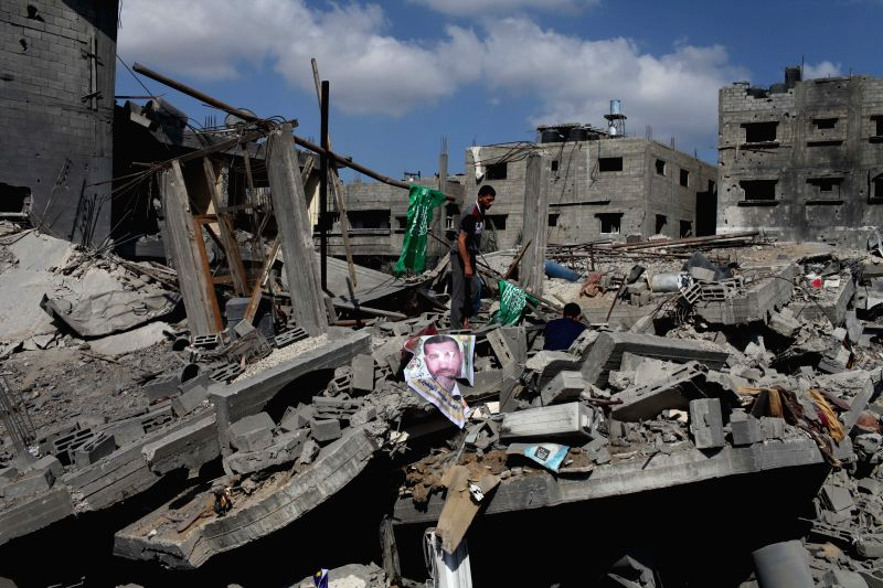 Palestinians inspect the rubble of destroyed buildings and houses at Al-Shejaeiya in eastern Gaza City, July 26, 2014. Gaza heath ministry confirmed on Saturday that ..