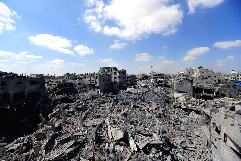 Photo taken on July 26, 2014 shows the rubble of destroyed buildings and houses at Al-Shejaeiya in eastern Gaza City. Gaza heath ministry confirmed on Saturday that ...