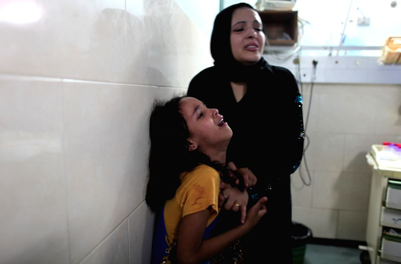 Relatives of a Palestinian who was killed in an Israeli airstrike weep at the al-Shifa hospital in Gaza City, July 28, 2014. Ten Palestinians were killed and 40 ...