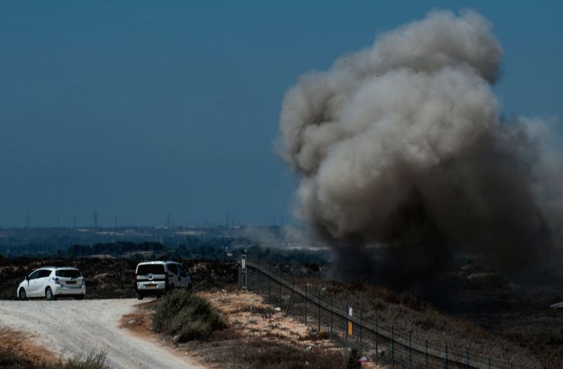 Photo taken on July 29, 2014 shows the site attacked by a mortar shell at an open area near Road 34 near Sderot, south Israel bordering the Gaza Strip. The mortar ...