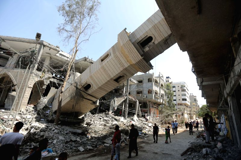 Palestinians inspect the damage of Al-Sousi mosque that was destroyed in an Israel strike, at the Shati refugee camp, in the northern Gaza City, on July 30, 2014. The ..