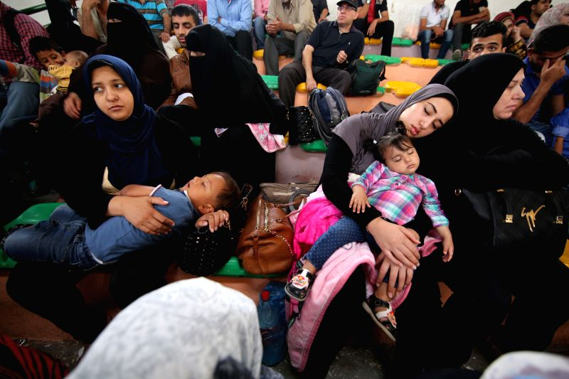 GAZA, June 1, 2016 - Palestinians wait for travel permit to cross into Egypt through the Rafah border crossing, in the southern Gaza Strip, on June 1, 2016. The Egyptian authorities on Wednesday ...