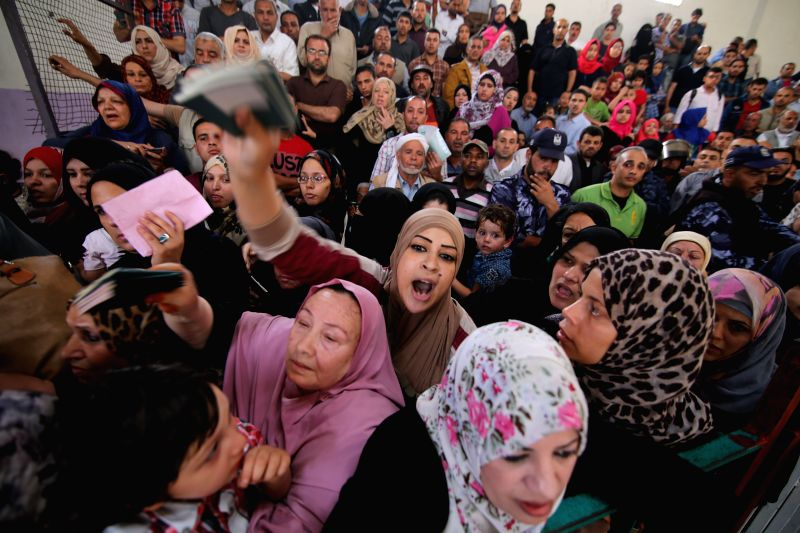 GAZA, June 2, 2016 - A Palestinian woman asks for a travel permit to cross into Egypt through the Rafah border crossing, in the southern Gaza Strip, on June 2, 2016. The Egyptian authorities on ...