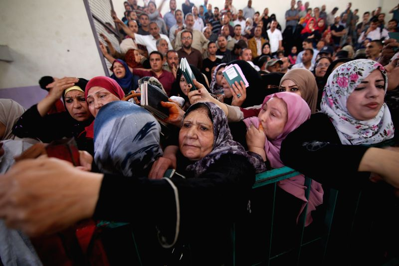 GAZA, June 2, 2016 - Palestinian women ask for a travel permit to cross into Egypt through the Rafah border crossing, in the southern Gaza Strip, on June 2, 2016. The Egyptian authorities on ...