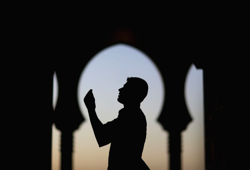 A man attends evening prayers at al-Khaldi mosque on the beachfront north of Gaza City on June 27, 2014. Muslims around the world celebrate Ramadan, the holiest month ..