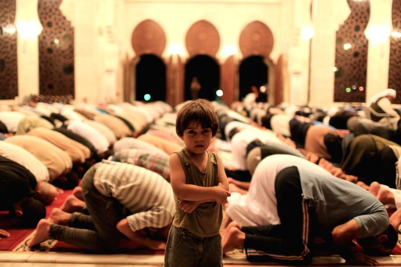 """Palestinian Muslims perform the """"tarawih"""" prayer marking the first eve of Islam's holy month Ramadan at al-Khaldi mosque on the beachfront north of Gaza City"""