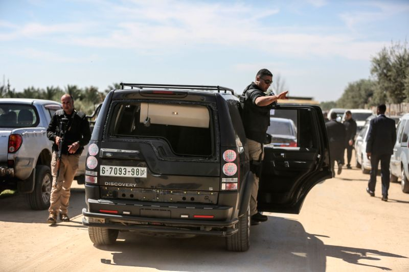 GAZA, March 13, 2018 - A damaged vehicle of the convoy of Palestinian Prime Minister Rami Hamdallah is seen after an explosion in Gaza Strip on March 13, 2018. An explosive went off Tuesday morning ... - Rami Hamdallah