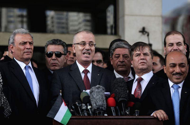 Palestinian unity government Prime Minister Rami Hamdallah (C) speaks during a press conference in Gaza City, on March 25, 2015. Rami Hamdallah said upon his arrival ... - Rami Hamdallah