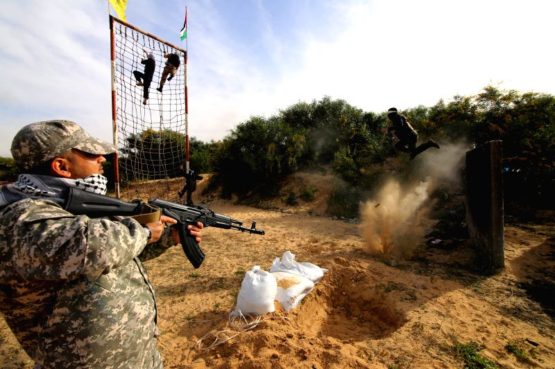 Members of the Al-Aqsa Martyrs Brigades, armed wing of the Palestinian Fatah movement, take part in a military training in the southern Gaza Strip City of Rafah, ...