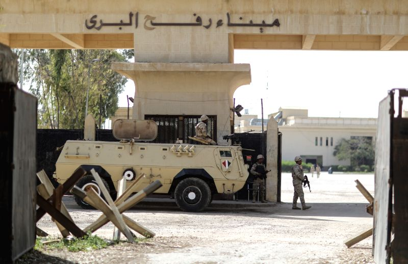 Egyptian soldiers are seen guard at the Rafah crossing point between Egypt and the southern Gaza Strip, March 9, 2015. Egypt on Monday reopened Rafah crossing point on ...