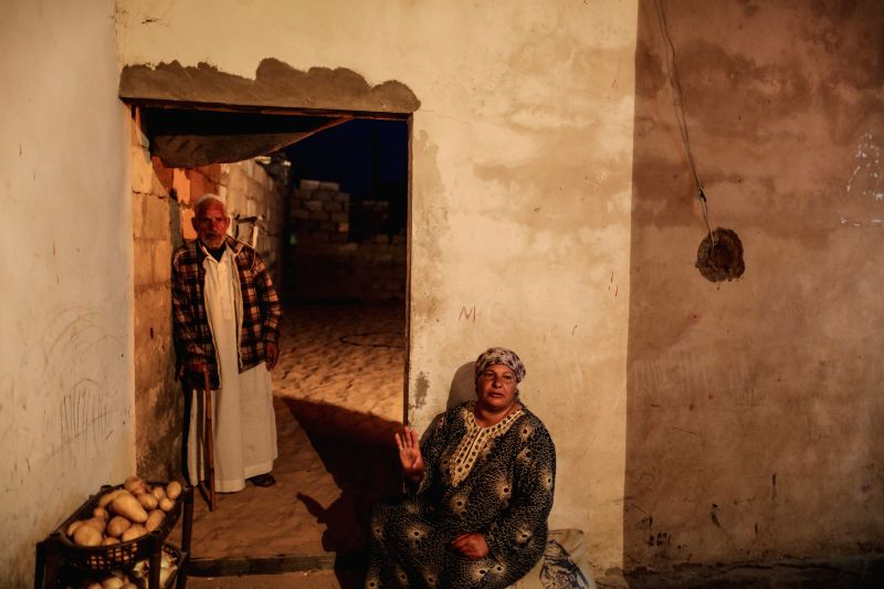 GAZA, May 10, 2016 - A Palestinian couple stay inside their house in a devastated area in the city of Khan Younis, southern Gaza Strip, on May 9, 2016. Since Hamas took over Gaza by force in 2007, ...
