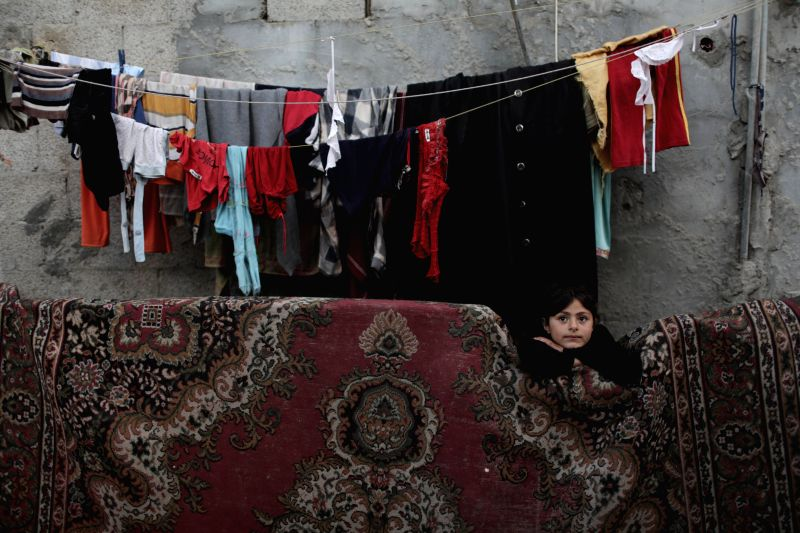 "A Palestinian refugee girl plays outside her house in El-Shatte refugee camp in the west of Gaza city, on May 12, 2014. Palestinians will mark ""Nakba"" ..."