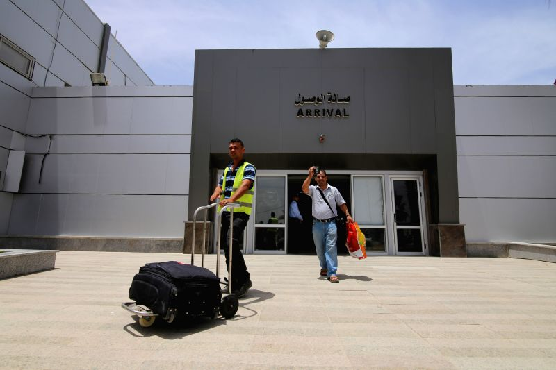 A Palestinian man returns to Gaza through Rafah crossing point between Egypt and the southern Gaza Strip, May 26, 2015. The Egyptian authorities on Tuesday reopened the ...