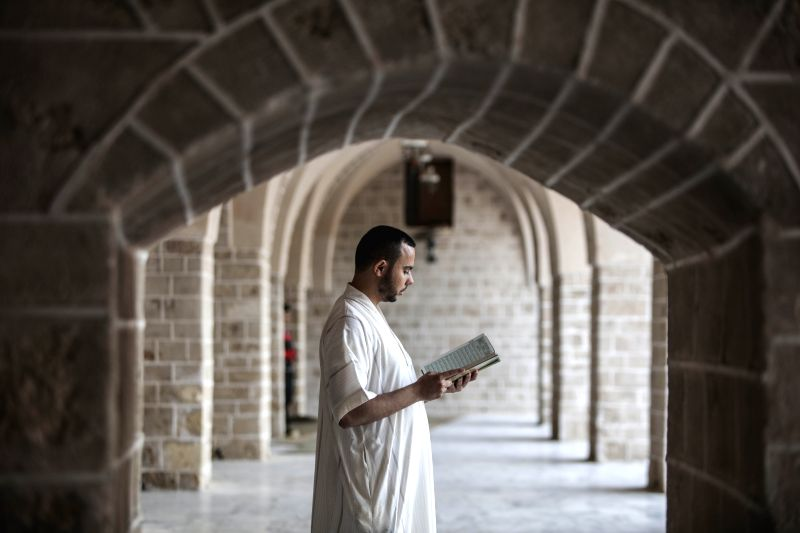 GAZA, May 28, 2017 - A Palestinian man reads Quran at a mosque in Gaza City, on the second day of the Muslim fasting month of Ramadan, on May 28, 2017. Muslims around the world celebrate Ramadan, the ...
