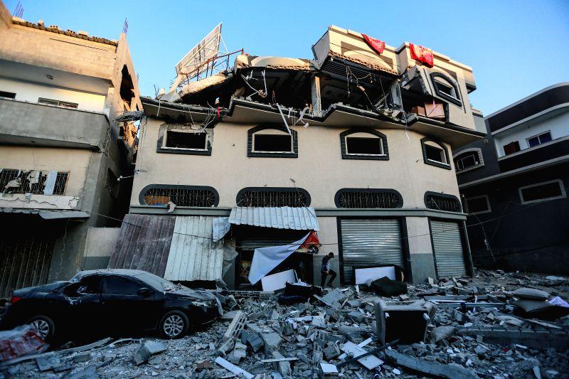 GAZA, Nov. 12, 2019 (Xinhua) -- A Palestinian inspects the damaged house of Islamic Jihad leader Baha Abu al-Atta after an Israeli attack in Gaza City, Nov. 12, 2019. Baha Abu al-Atta, a senior militant and leader of al-Quds Brigades, the armed wing