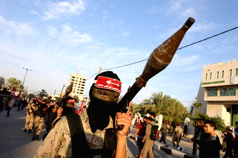 Gaza (Palestine): A Palestinian militant from the Popular Front for the Liberation of Palestine (PFLP) take part in a march to celebrate the 47th anniversary of the group's founding in the southern ..