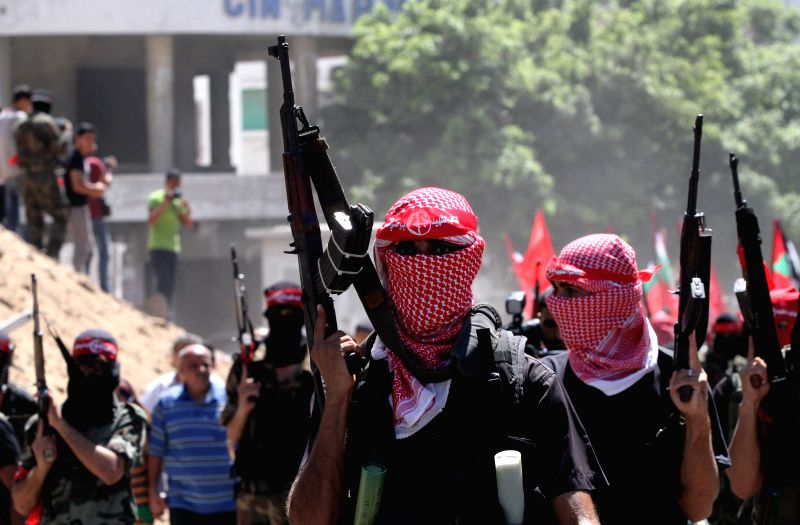 Palestinian militants from the Popular Front for the Liberation of Palestine (PFLP) take part in a military parade one week after the Egypt-mediated ceasefire between .
