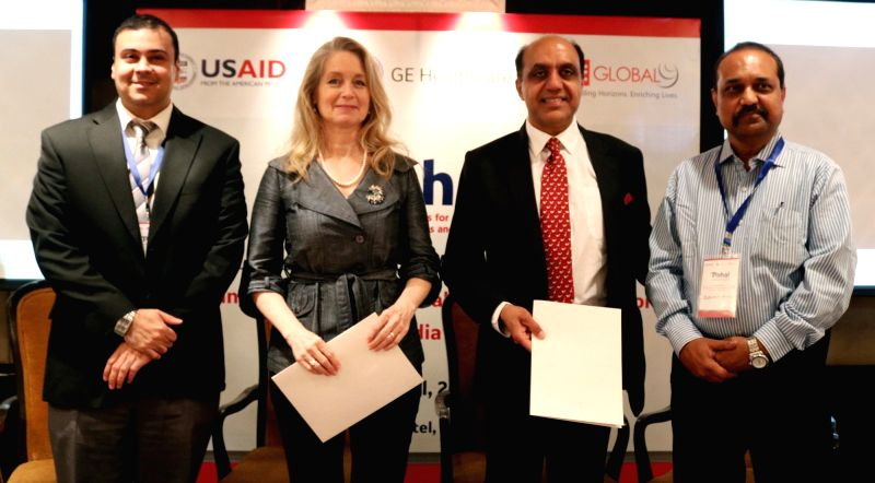 GE Healthcare President and CEO Terri Bresenham, PAHAL  project director L.M. Singh, USAID/India Health Office Director Xerses Sidhwa during a programme organised to sign MoU between IPE ... - L. and M. Singh