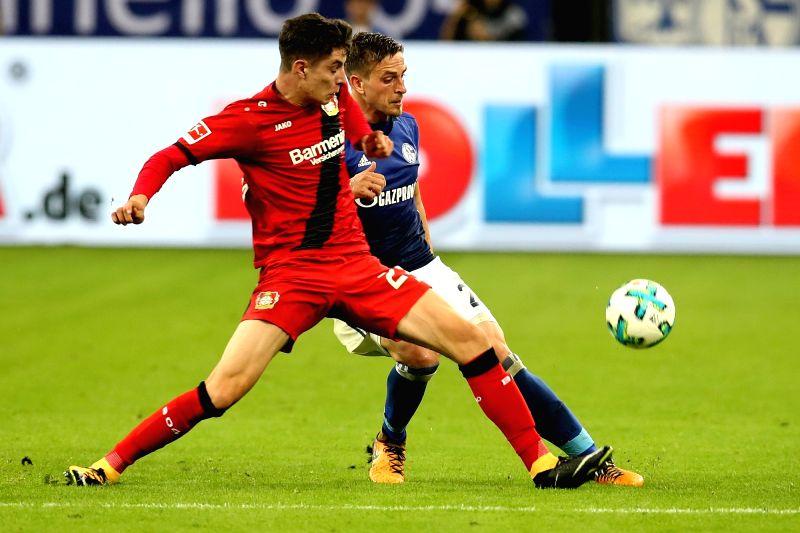 GELSENKIRCHEN, Sept. 30, 2017 - Bastian Oczipka (R) of Schalke 04 vies with Kai Havertz of Bayer Leverkusen during the German Bundesliga match between Schalke 04 and Bayer Leverkusen in ...