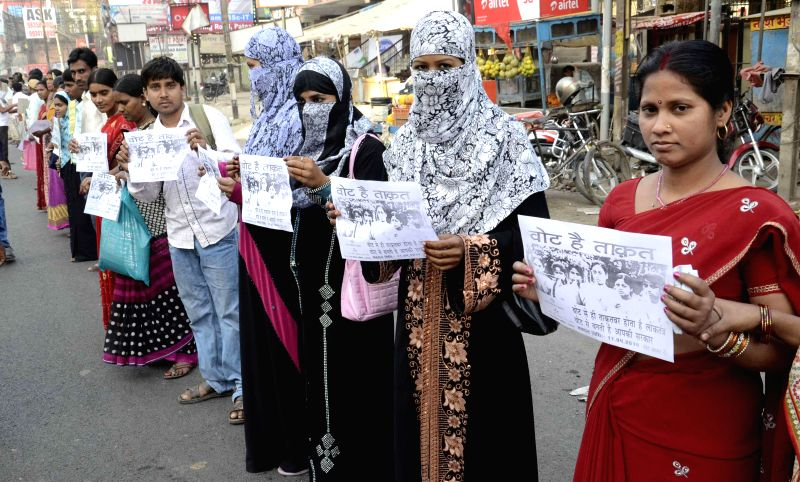 General public and school children form a human chain to build awareness for vote in Patna on April 12, 2014.