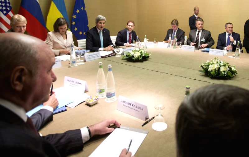 Photo taken on April 17, 2014 shows a view of the talks on Ukraine in Geneva, Switzerland. The European Union, Russia, United States and Ukraine started here ...