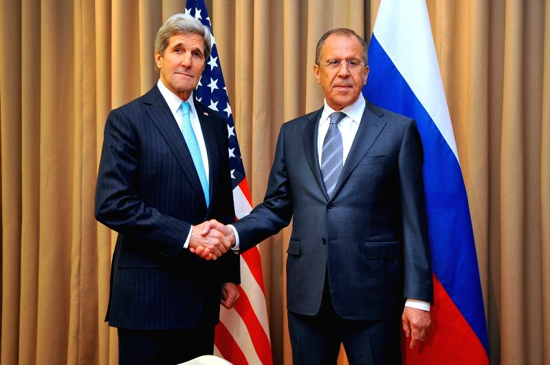 U.S. Secretary of State John Kerry (L) shakes hands with Russian Foreign Minister Sergei Lavrov during their bilateral talks before the talks on Ukraine in Geneva, . - Sergei Lavrov