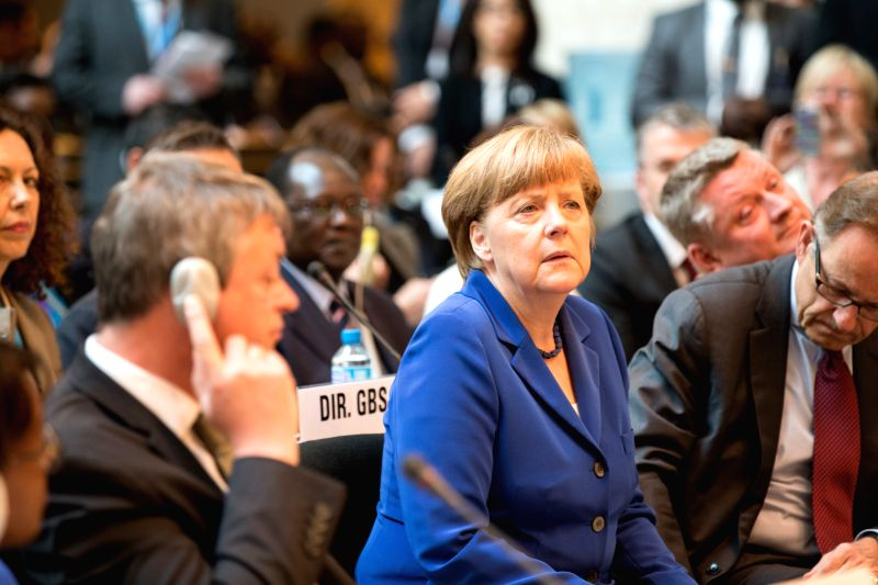 German Chancellor Angela Merkel (front C) attends the opening ceremony of the 68th session of the World Health Assembly (WHA) in Geneva, Switzerland, on May 18, 2015. ...