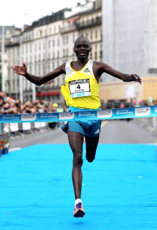 Simon Mukun from Kenya reaches the finish line first during the Geneva Marathon for Unicef 2014 around Geneva, Switzerland May 4, 2014. About 2,000 runners ...