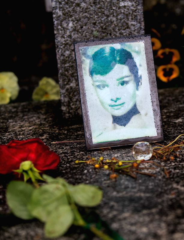 A rose is placed at the grave of actress Audrey Hepburn in Tolochenaz village  in Switzerland, May 4, 2015. Audrey Hepburn, born in Brussels, Belgium, May 4, 1929,  ...