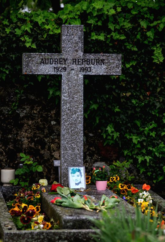 Flowers are placed at the grave of actress Audrey Hepburn in Tolochenaz village in Switzerland, May 4, 2015. Audrey Hepburn, born in Brussels, Belgium, May 4, 1929, ...