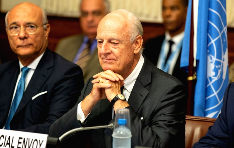 GENEVA, Sept. 14, 2018 - UN Special Envoy of the Secretary-General for Syria Staffan de Mistura (R) attends a meeting, during the consultations on Syria, at the European headquarters of the United ...