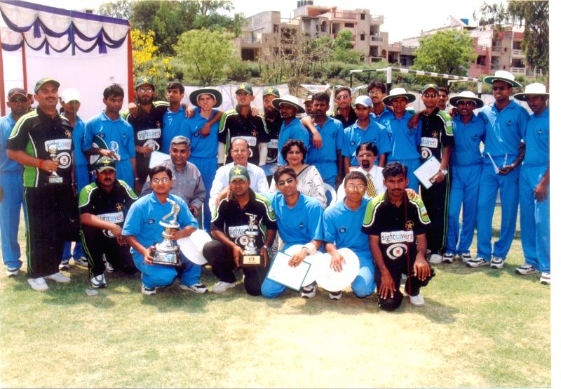 George (second row, fourth from right) with visually challenged cricket players.