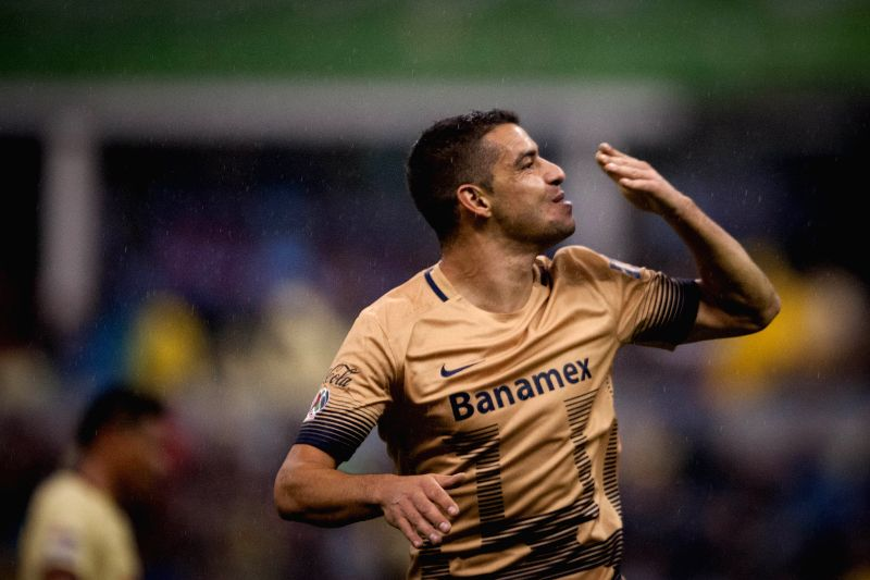 Gerardo Alcoba of Pumas de la UNAM celebrates his score during the Semi-Finals of the Opening Tournament of the MX League against America, at Azteca Stadium in ...