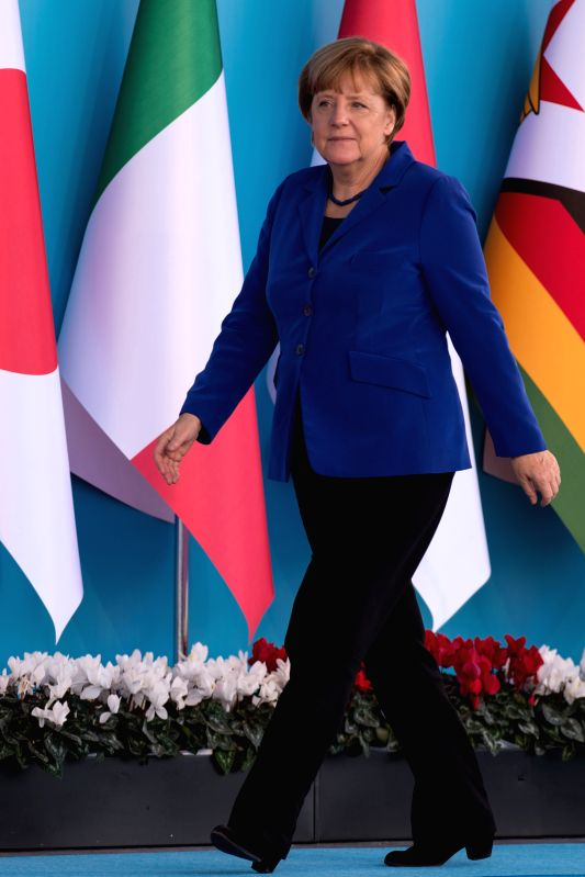 German Chancellor Angela Merkel arrives at the welcoming ceremony of G20 Summit held in Antalya, Turkey, on Nov. 15, 2015. The two-day summit kicked off on Sunday. ...