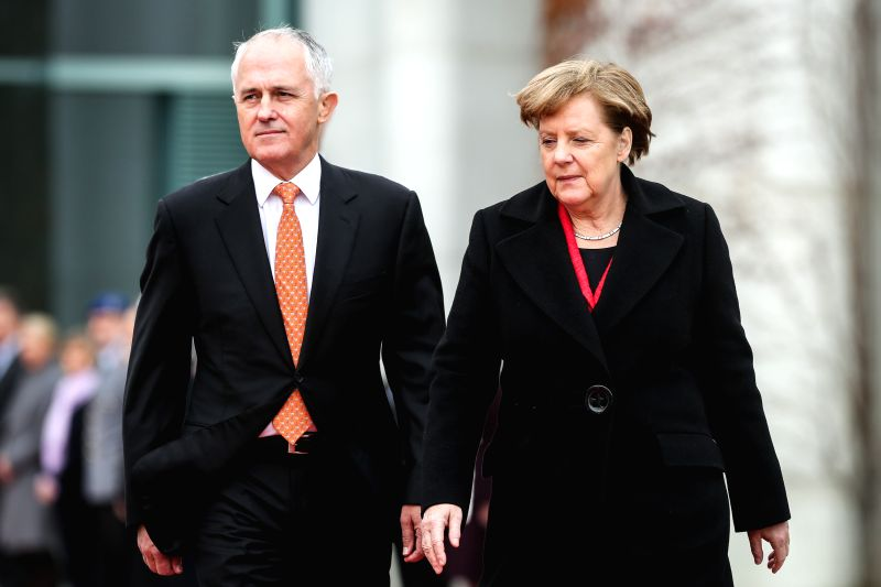German Chancellor Angela Merkel (R) and visiting Australian Prime Minister Malcolm Turnbull attend a welcome ceremony at the Chancellery in Berlin, Germany, on Nov. ... - Malcolm Turnbull