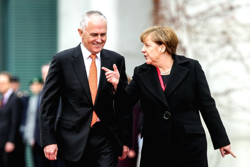 German Chancellor Angela Merkel (R) talks with visiting Australian Prime Minister Malcolm Turnbull during a welcome ceremony at the Chancellery in Berlin, Germany, ... - Malcolm Turnbull