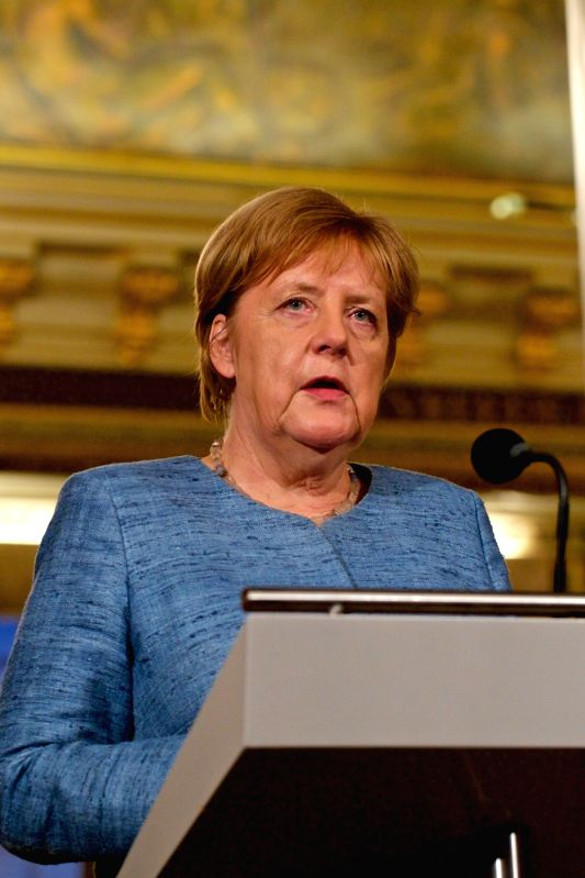 :German Chancellor Angela Merkel speaks at a joint press conference with Dutch Prime Minister Mark Rutte in The Hague, the Netherlands, Oct. 10, 2018. Dutch ...