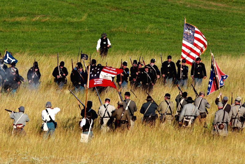 Actors playing Federal and Confederate forces clash during reenactment activities marking the 151st anniversary of the U.S. Civil War battle in Gettysburg, ...