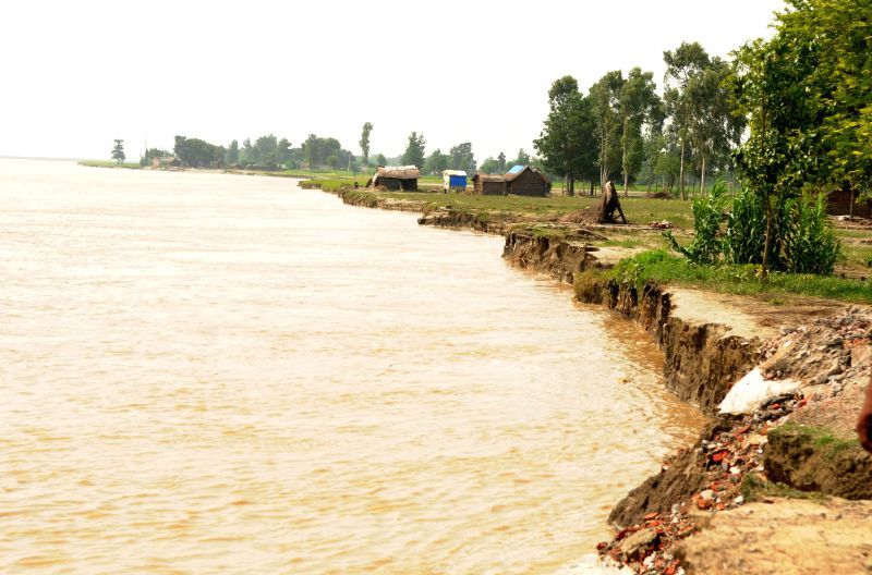 Ghagra river that was in spate due to flash floods is now receding. While recding, the river now causing widespread erosion in  Bahraich, Uttar Pradesh.