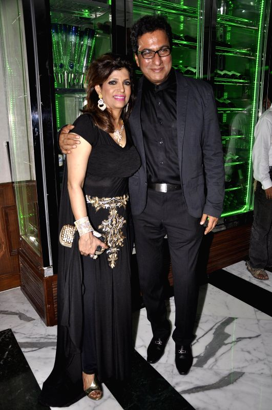 Ghazal singer Talat Aziz along with his wife Bina Aziz during the Medha Jalota's birthday party in Mumbai on June 25, 2014.