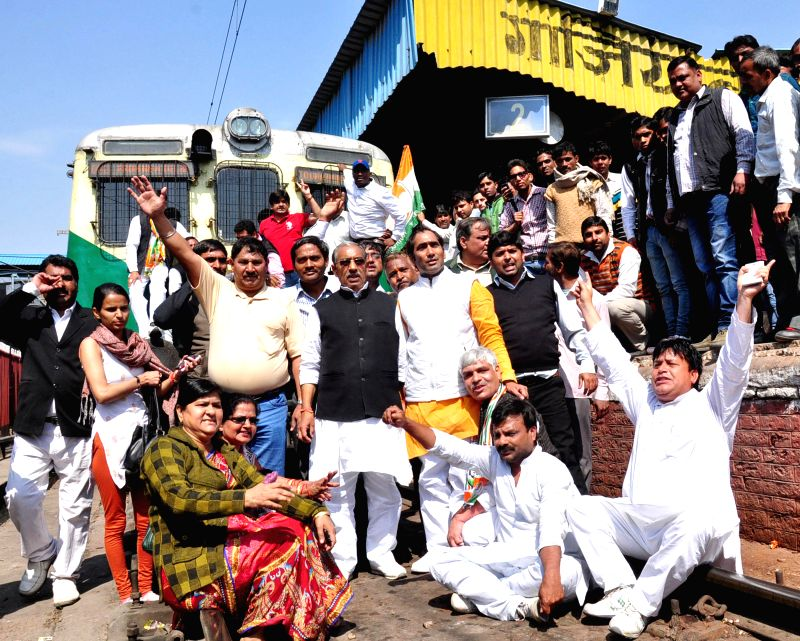 Congress workers participate in `Rail Roko Andolan` at Ghaziabad railway station on March 12, 2015.