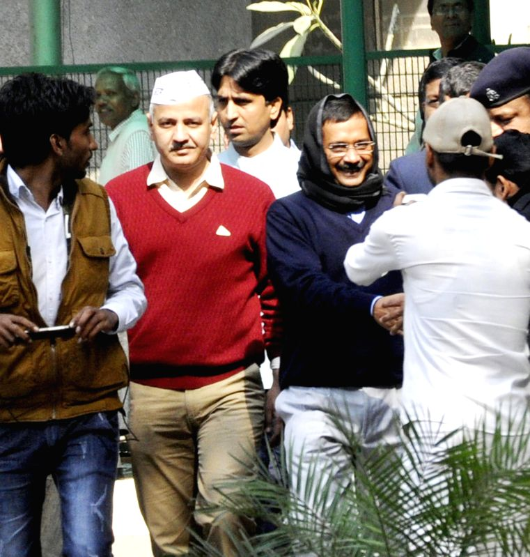 Delhi Chief Minister Arvind Kejriwal with Aam Aadmi Party (AAP) leaders Manish Sisodia, Kumar Vishwas and others at Kejriwal's residence in Ghaziabad, Uttar Pradesh on Feb 14, 2015. - Arvind Kejriwal