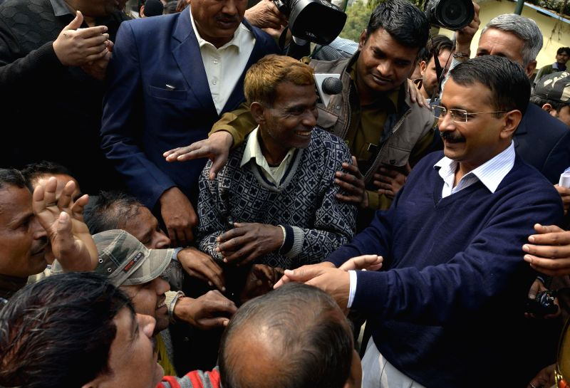 Delhi Chief Minister Arvind Kejriwal during a meeting with e-rickshaw operators outside his residence in Kaushambi, Ghaziabad on Feb 17, 2015. - Arvind Kejriwal