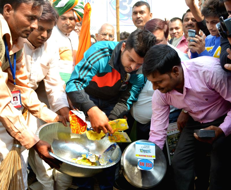 Indian cricketer Suresh Raina participates in Clean India Campaign in Ghaziabad on Nov 19, 2014.