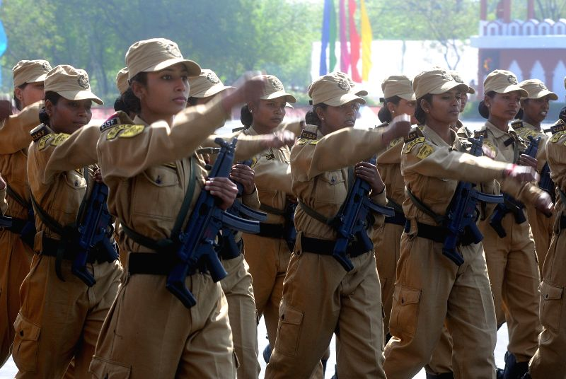 Women personnel of CISF march during the 46th CISF Raising Day Function at Indirapuram, in Ghaziabad on March 10, 2015.