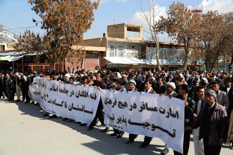 Members of the Hazara community rally to protest against the kidnapping of 30 passengers allegedly by unknown armed men in Ghazni province, eastern Afghanistan, ...
