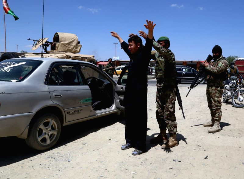 GHAZNI, May 07, 2017 - Afghan security personnel search a passenger during a military operation in Ghazni province, eastern Afghanistan, May 7, 2017.