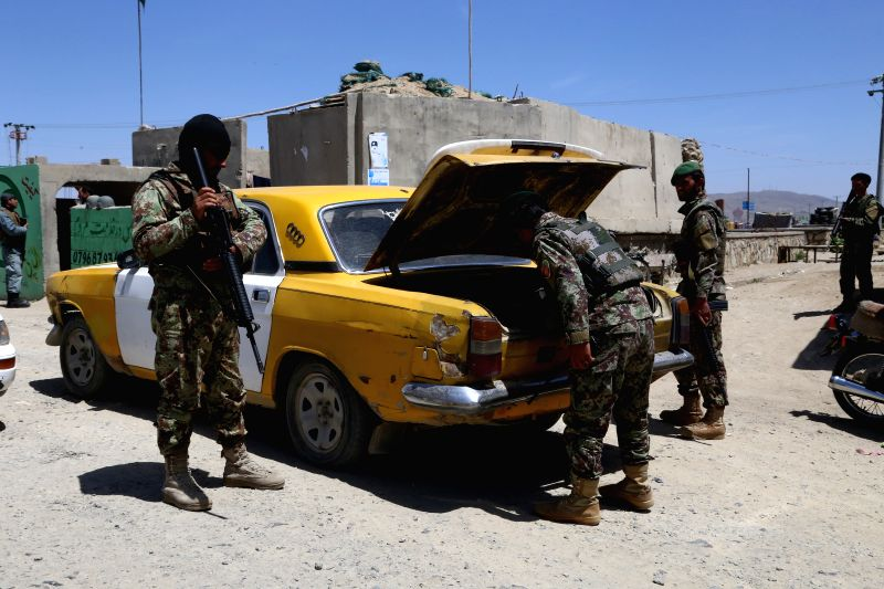 GHAZNI, May 07, 2017 - Afghan security personnel search a vehicle during a military operation in Ghazni province, eastern Afghanistan, May 7, 2017.